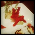 It's a deer garnish made of beets from my fave sushi restaurant. Also, an obsession..fun and creative garnishes.