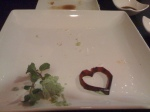 Empty sushi plate, before I bit into the heart!