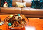 The color scheme of our living room is neutral with turquoise. So this is my table centerpeice for the living room with pinecones I made with ornaments.