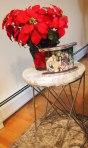 Our new side table with a poinsettia and my fav family photo.