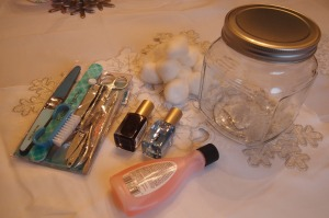 All the items needed for a manicure set in a jar