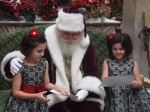 Santa with the girls talking about their lists.