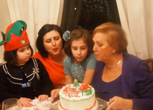 My mom and I with my girls blowing the candles out
