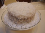 Frosted cake covered in Coconut Flakes!
