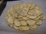 place the potato slices around and atop one another in a flower pattern