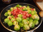 In a pan on medium-high heat add oil, shallots, Brussels Sprouts and chopped pancetta