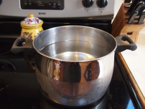 Start with cold water. Do NOT turn heat on until all items are in the stock pot.