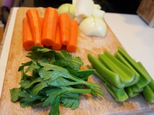The vegetables: 2 medium yellow onions quartered, 4 carrots cut in half, and 4 organic celery stalks halved with leaves kept whole.