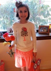 She got three valentine flowers!