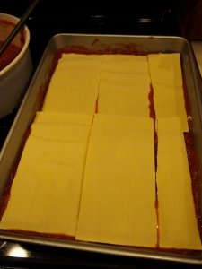 2nd layer of pasta- repeating with layering the mixture and sauce on top, repeat...