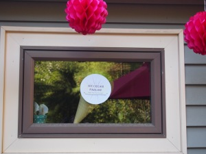 Window decorations.  On the inside it's the balloon ice cream decor, but the outside it's a cute disc I made for the sundae part of the day.