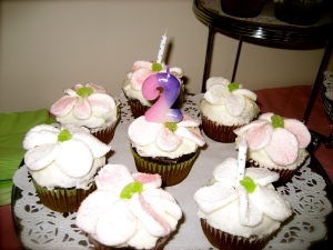 Cupcakes with Marshmallow flowers and green maraschino cherry centers