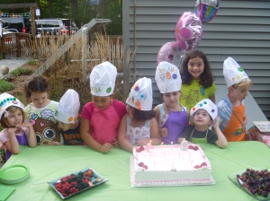 Some of the kids together in their hats and aprons