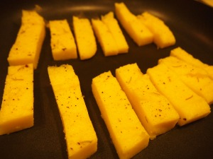 In a dry non-stick pan, place cut pieces of polenta to brown.