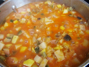 Simmer for 30 minutes until the potatoes are soft and the eggplant has basically melted into the dish.