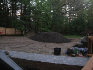 After setting the patio, working on the lawn.