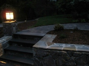 The stone work from the front we had built, the  grass and plantings.  First photo of it complete