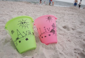 Their pail that I decorate every year.  (it's my fav thing at the beach! aside from the sun and ocean obvs!)
