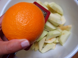 Grate an entire orange for the zest.