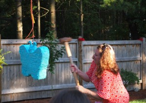 but we had to intervine..here is my sister in law showing the pinata who is boss.  ha!
