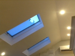 The old skylights revamped, but the biggest excitement are the new lights and AC unit!