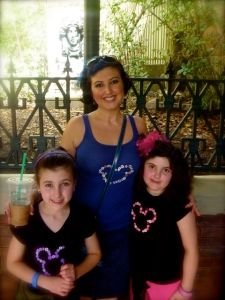 My girls and I waiting on The Haunted Mansion.. my fav ride at the park!
