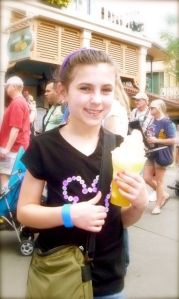 Eating a yummay Dole Whip float.  She ate the whole thing alone..not even a sip of pineapple fer her mamma :\