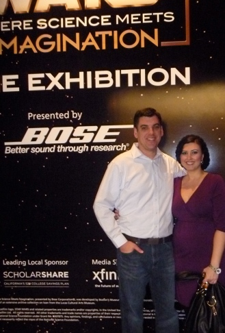 My husband and I in front of the entrance poster.