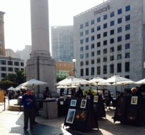 Union Sq was being set up at this early hour for an art market.