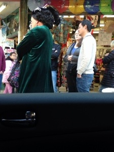 Driving through Chinatown on our way to pick up someone. I couldn't get the best pic of this. but, it is a drag queen walking tour through Chinatown. Loved him!