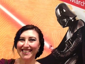 Selfie with a poster as the crew was all busy talking. nearby. Looks like Vader is chopping my noggin in half.
