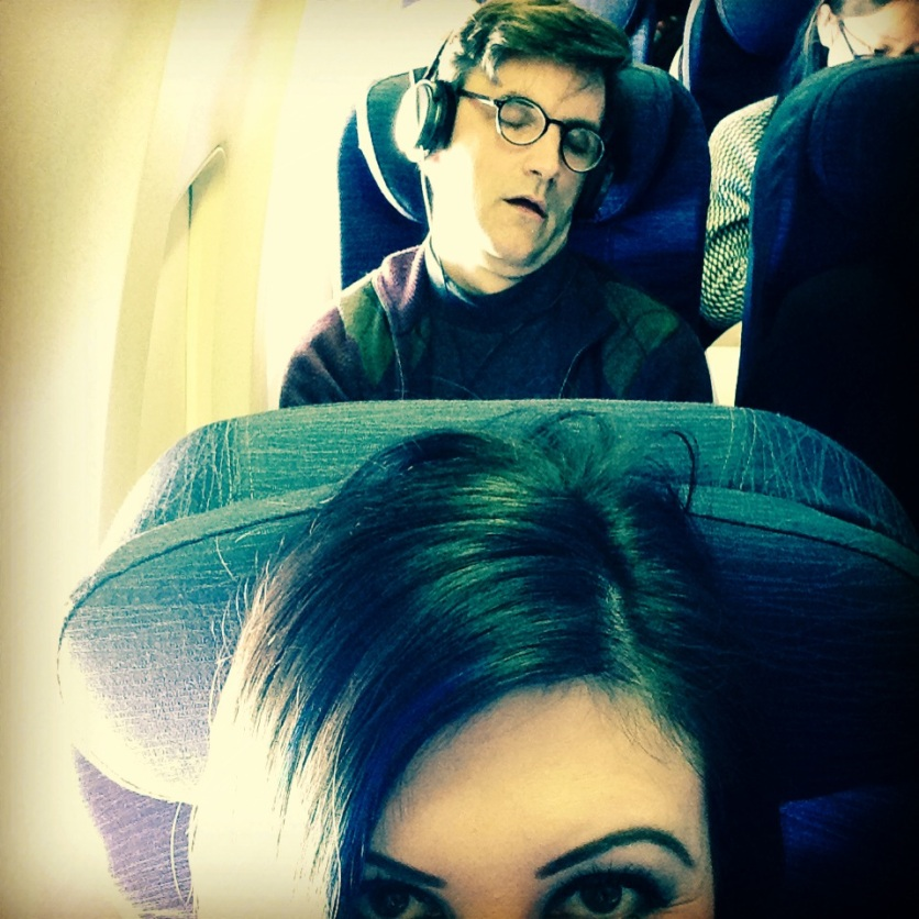 During our flight out to the west coast. our friend ed took a nap.