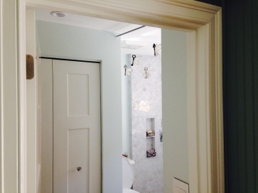 View from living room as you enter the bathroom.