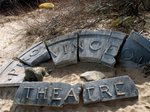 There was this cool vintage concrete sign in the sand of the beach .. so sad.
