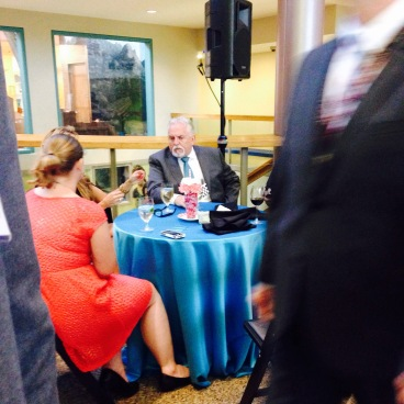 so.. I was sorta celebrity shy, and snuck a pick of him at his table talking...