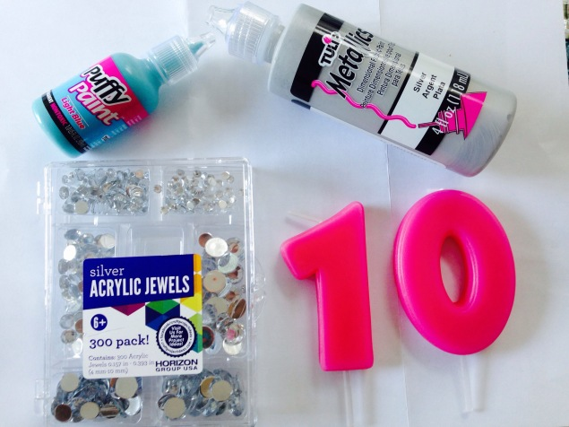 Got plain wax candles, a pack of rhinestones and puffy paints