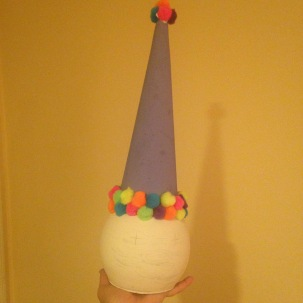 Glued pompoms and a painted floral foam cone