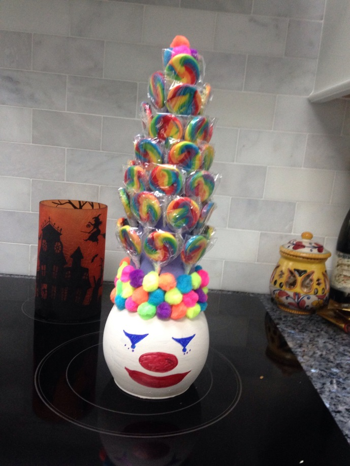To create a cool lollipop holder for the kids on the dessert table.
