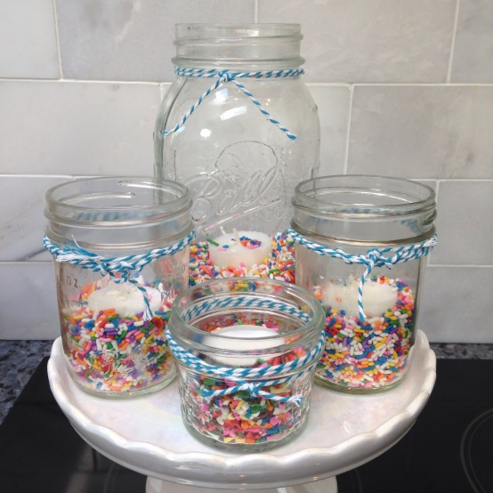 Made sprinkle candle holders for the tables. Super cute