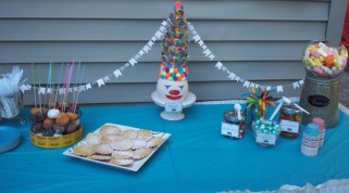 On the dessert table, I adorned it with mini white pennant flags
