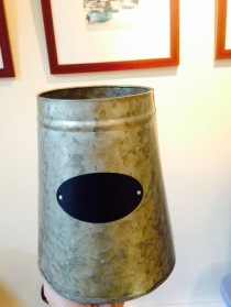 Found this first, a quirky tin pot holder