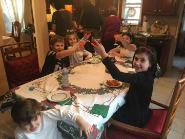 I stole this from my sister, i was not feeling to take pix... here is New Years Day dinner with my whole fam.. the kids cheering 2016!