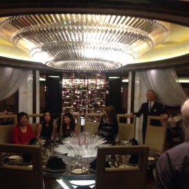 The chef's table for the tasting. You can see the curtains swagged to the sides.