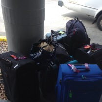 All our bags waiting for the car rentals!