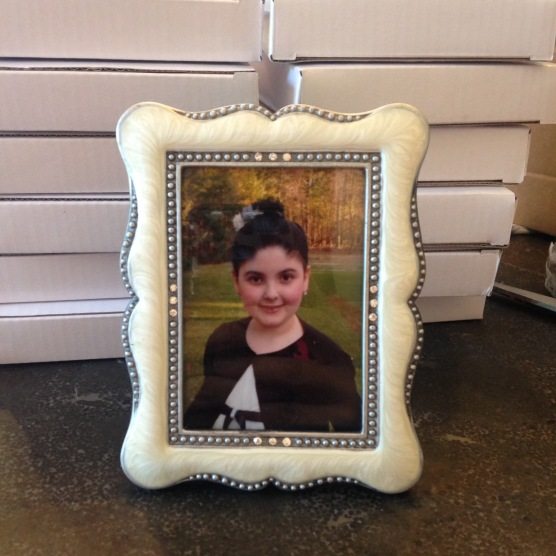 The favors...a vintage type frame with her cute picture in it.