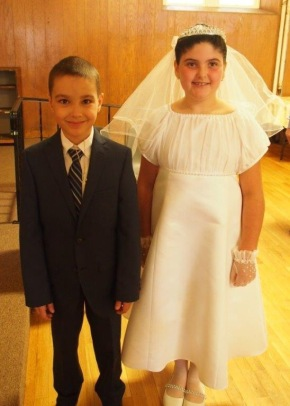 Super sweet she got to take communion with two of her best buddies! Here with one