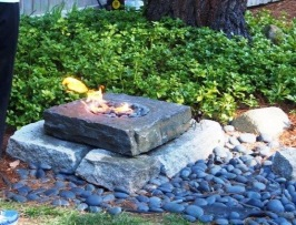 My husband created a fire pit out of our water fountain...uhm, it was too breezy to warm anything