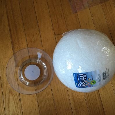 A ten inch foam ball and a clear bowl