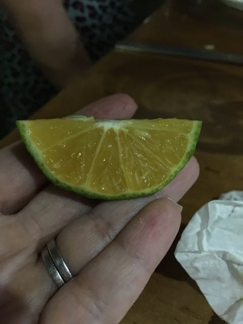 This is a lemon...it is green with a rich orange interior...