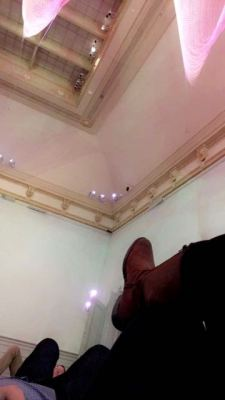Laying on the ground looking up at the Janet Echleman installation